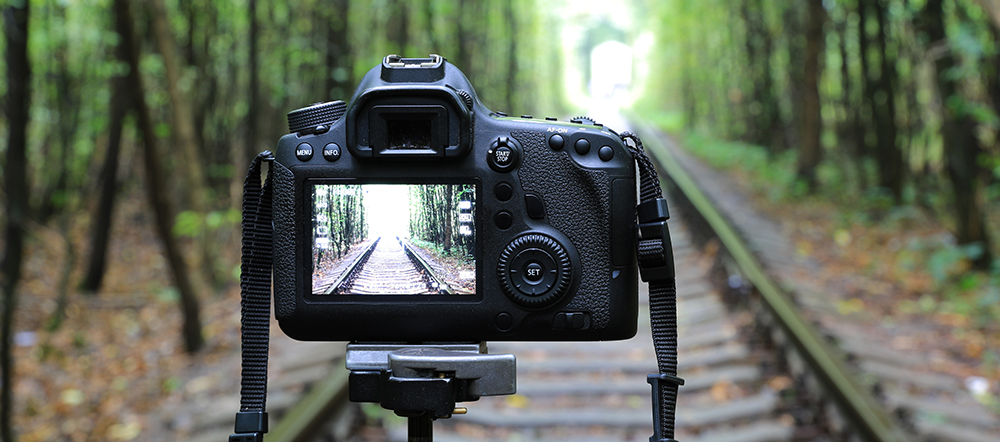 Abstract DSLR Camera on railway in forest; Shutterstock ID 327122660