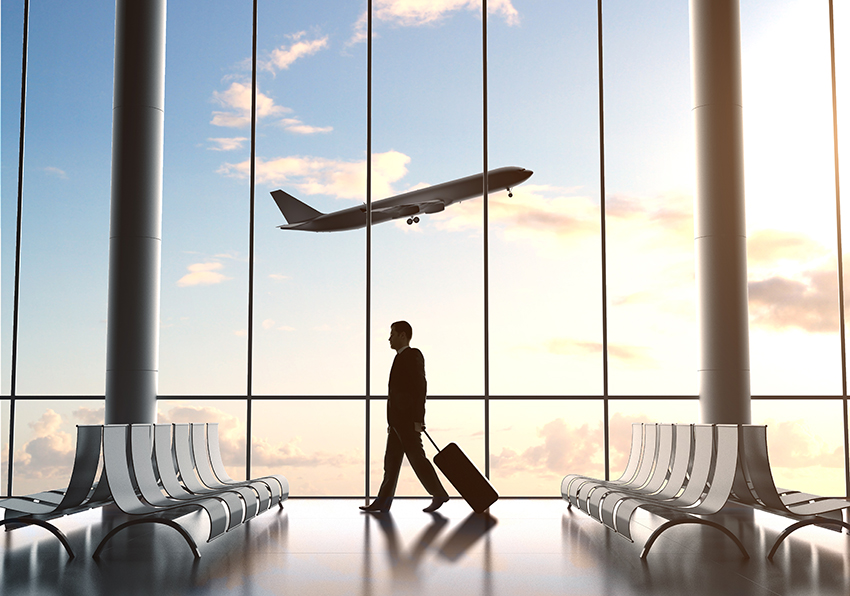 young man in airport and airplane in sky
